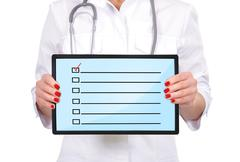 Checklist on touch pad Stock Photos