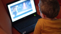 Kid watching cartoon on notebook Stock Footage