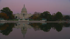US CAPITOL BUILDING WITH REFLECTION – SUNSET (PAN) - stock footage