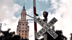 Miami 018HD, Sign of Railroad Crossing with Freedom Tower in Background Stock Footage