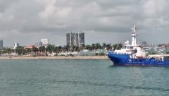 Miami 001HD, Shoreline with Car Traffic, a Ship is passing Palm Island Stock Footage