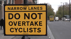 "A new ""Do Not Overtake Cyclists"" road sign, Westminster, London, UK. Stock Footage"