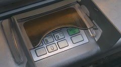 Entering PIN number at ATM machine, London, UK. Stock Footage