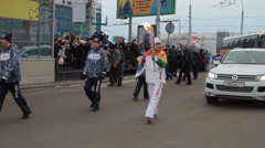 Olympic flame in Siberia, in honor of the 2014 Olympics Stock Footage