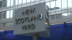 """The rotating """"New Scotland Yard"""" sign outside the Met Police HQ, London, UK. Stock Footage"""
