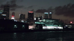 Miami 047HD, a Part of Skyline at Night. Cruise Ship leaves Harbor Stock Footage