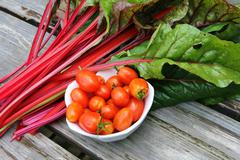 Cherry tomatoes and swiss chard Stock Photos