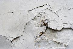 Cracked stucco - grunge background Stock Photos