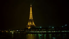 Eiffel Tower in Paris night lights view from Bir Hakeim Bridge Stock Footage