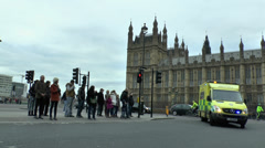 London ambulance with siren on an emergency call, Westminster, London, UK. Stock Footage