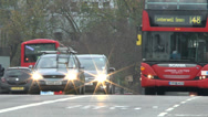 Stock Video Footage of Red London bus on Westminster Bridge, London, UK.