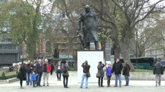 Stock Video Footage of Statue of Sir Winston Churchill, Parliament Square, London, UK.