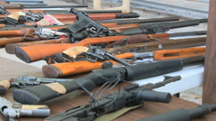 Firearms on table - stock footage