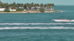 KeyWest 005HD, two Speed Boats are passing Tank Island Stock Footage