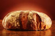 Stock Photo of large loaf of traditionally baked bread on the table