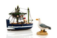 Fishing boat and sea gull Stock Photos