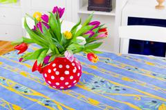 Bouquet tulipa at the table Stock Photos