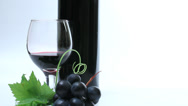 Stock Video Footage of Red / black grapes and wine glass decor