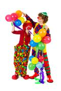 Couple funny clowns with balloons Stock Photos
