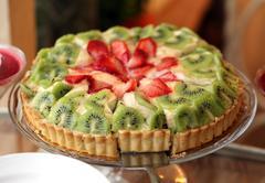 Fruit cake with strawberries and kiwi Stock Photos