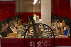 automated sushi restaurant in dotombori, osaka, japan - stock photo