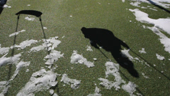 Shadow of kid in swing - stock footage