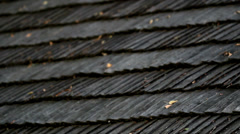 Leaves on top of the cedar wooden roof shingles Stock Footage