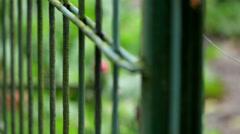 Long steel prison fence Stock Footage