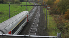 People train going fast in railway on beautiful autumn forest Stock Footage