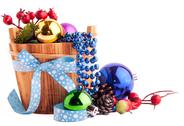 Stock Photo of christmas background with wood bucket, cones, color balls and berries