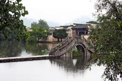 Famous stone bridge leading to ancient hongcun village in anhui province, chi Stock Photos