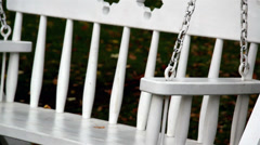 Up-close image of the bench swing Stock Footage