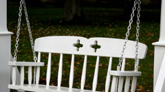 Chain safely attached to the bench swing Stock Footage