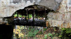 water dripping from stone bridge - stock footage
