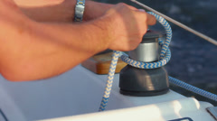 Sailor ties rope on handling appliance Stock Footage