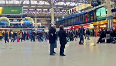 Zoom timelapse of commuters inside victoria railway station Stock Footage
