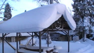 Stock Video Footage of roof of the shed is covered in a lot of snow