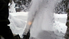 Removing snow using a snowblower machine Stock Footage