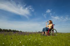Handicapped woman on wheelchair Stock Photos