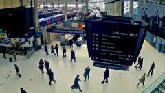 london, top view zoom timelapse of commuters inside waterloo railway station - stock footage