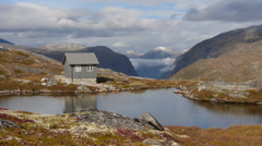 Small house in norway mountains 1 Stock Footage