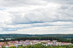 View over residential neighborhood surrounded by nature - stock photo