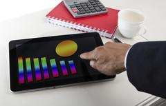 Business graph report on  tablet screen monitor Stock Photos