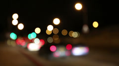 Blurred background of moving traffic at night - stock footage