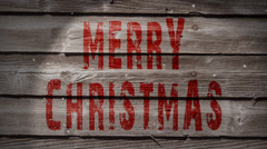Merry Christmas Weathered Wood and Snow Loop Stock Footage