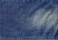 texture of jeans cloth with a seam - stock photo