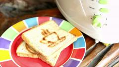 morning toasting whole wheat bread - stock footage