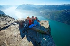 Happy family on  preikestolen massive cliff top (norway) Stock Photos