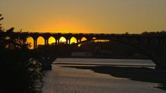 SUNSET THROUGH BRIDGE – GOLD BEACH, OREGON (CLOSE) Stock Footage