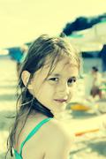 Adorable little girl on beach vacation.vintage color toned image Stock Photos